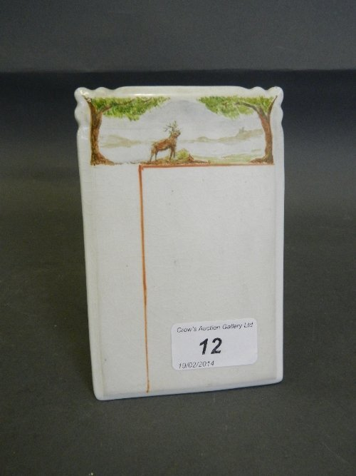 A Carltonware menu holder decorated with a stag beneath