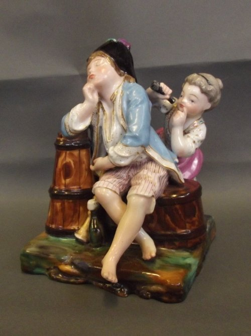 A C19th Continental porcelain figure group depicting a