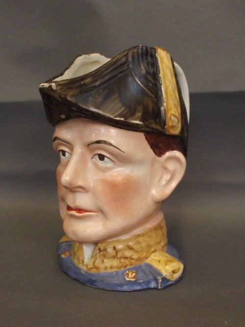 A Staffordshire jug in the form of a naval officer,