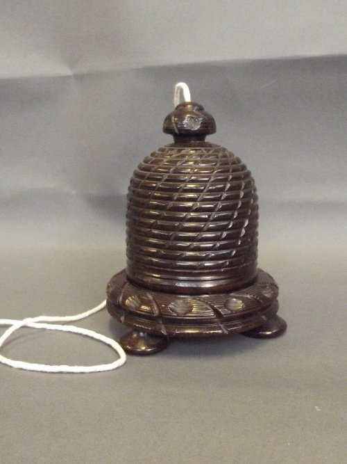 A wooden string box carved in the form of a beehive,