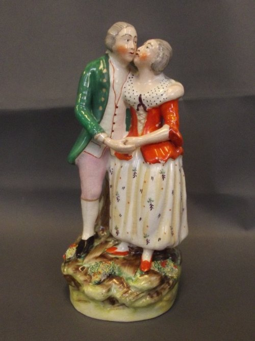 A Thomas Parr Staffordshire figure group of a courting