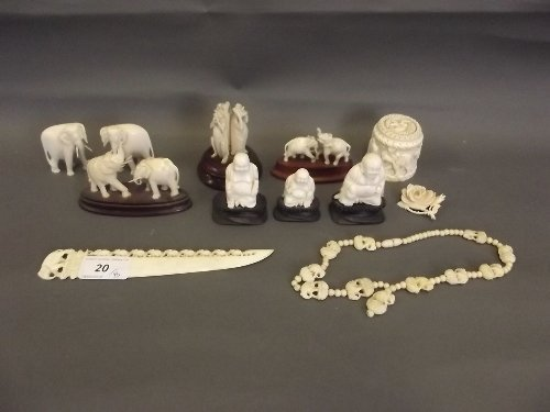A quantity of early C20th carved ivory elephants,