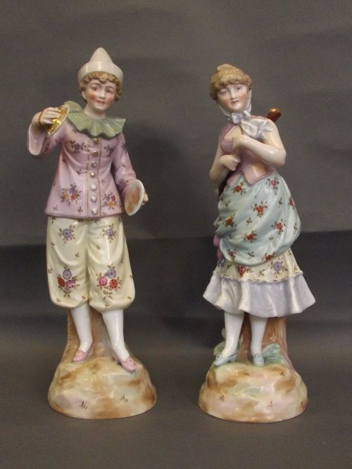 A pair of early C20th Continental ceramic figures of a