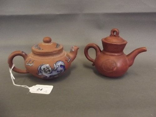 A Chinese Yixing teapot with enamel decoration and