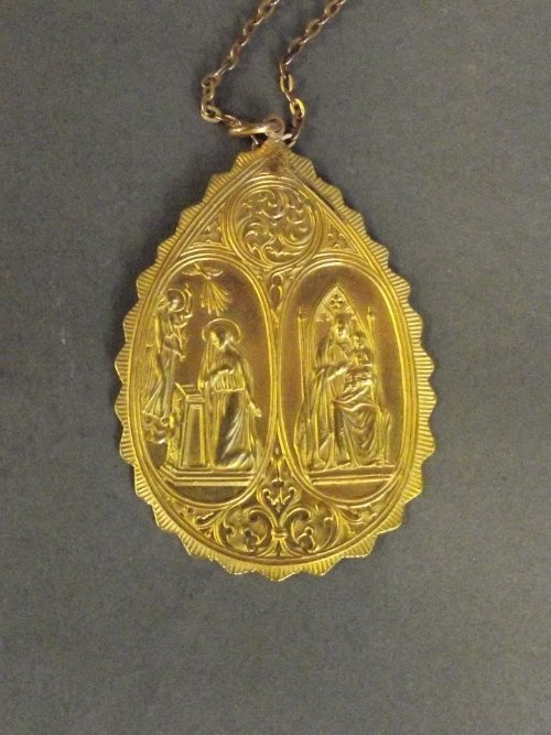 A high carat gold pendant on chain depicting the