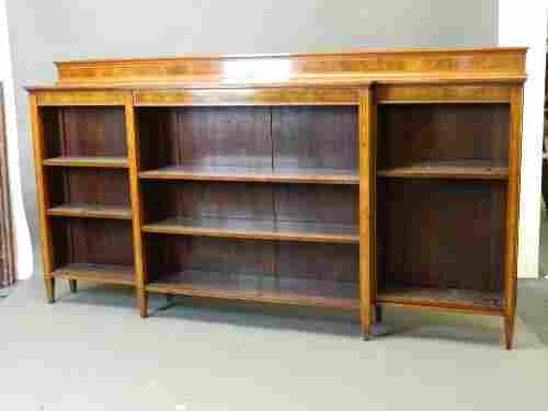 An Edwardian mahogany breakfront open bookcase with