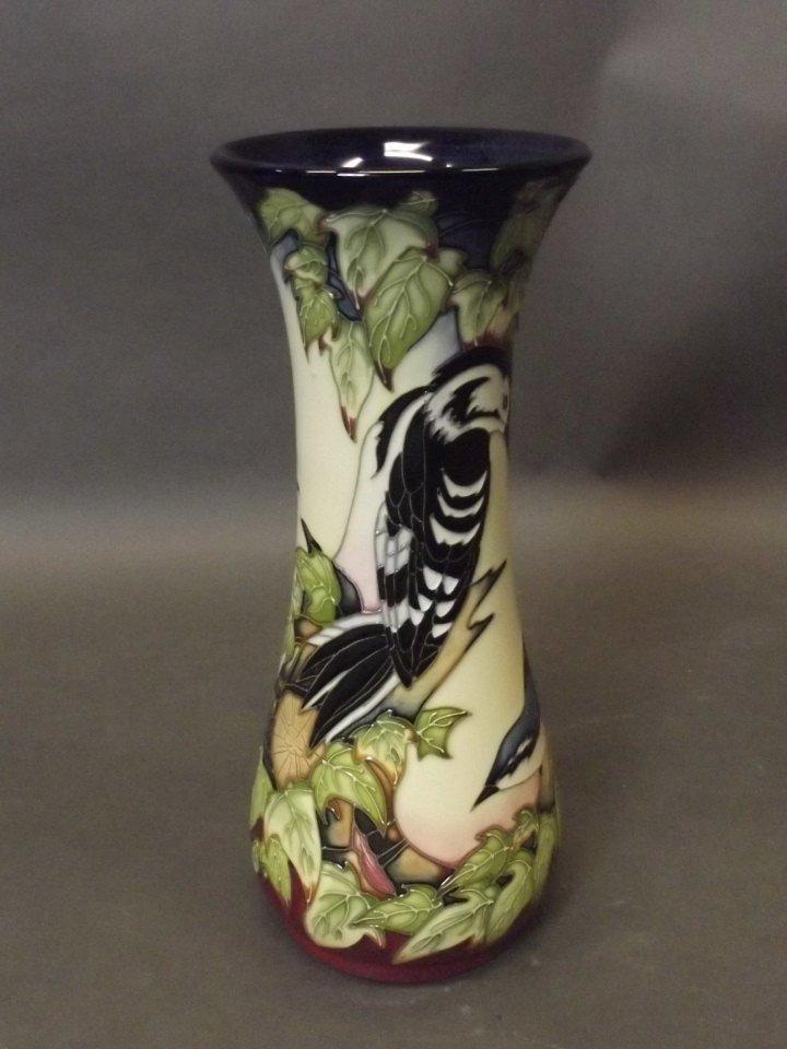 A Moorcroft pottery Inglewood pattern vase decorated