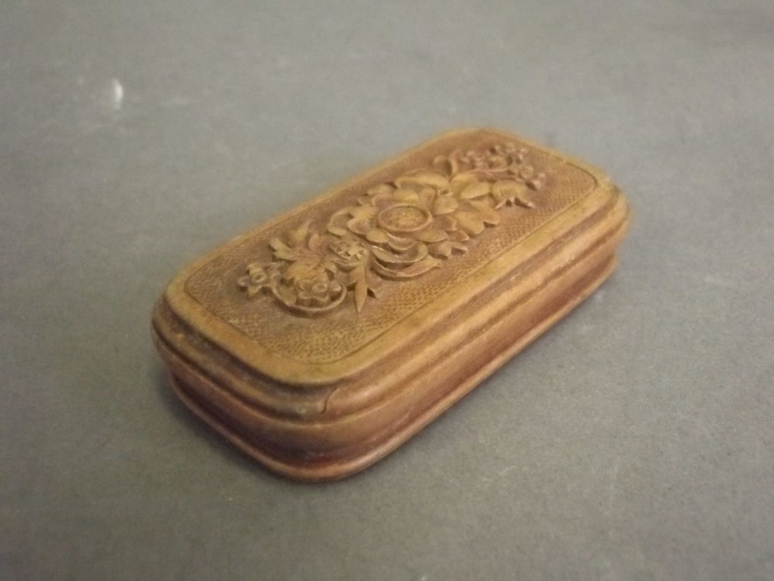 A small Victorian wooden pill box with carved floral