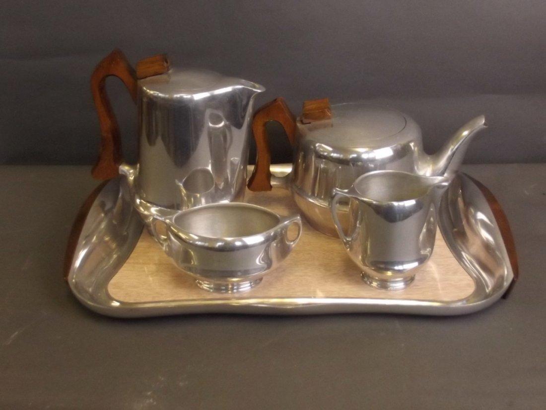 A Picquot ware tray, teapot, hot water jug, sugar bowl,