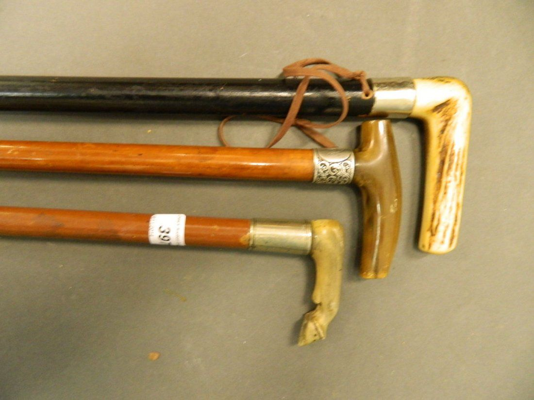 A horn handled walking stick carved in the form of a
