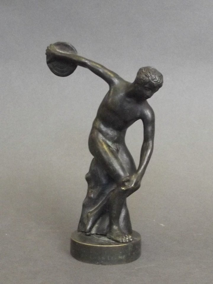 A C19th bronze figure in the form of a discus thrower,