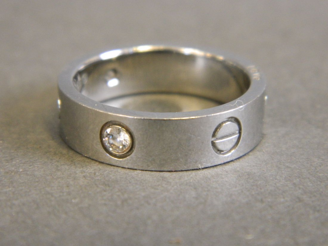 An 18ct white gold Cartier 'Love' ring set with three