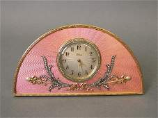A 14ct gold and enamel desk clock inset with diamonds