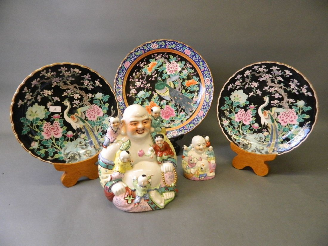 A large Oriental famille noir porcelain charger with