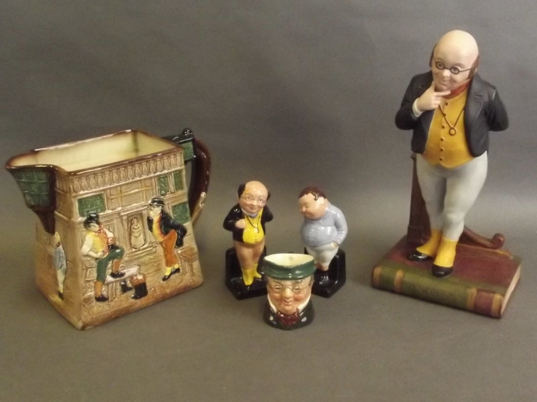 A small collection of Dickens pottery figures and jugs