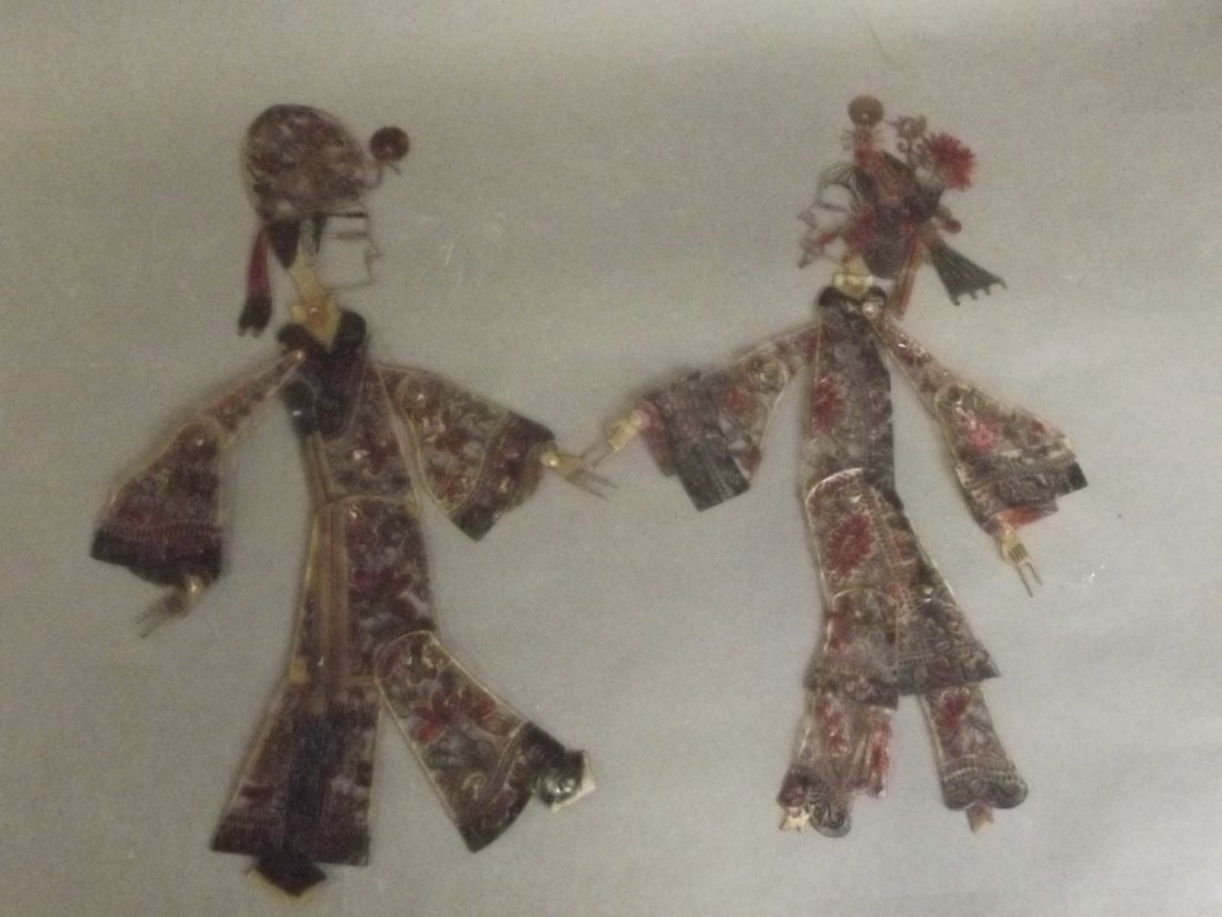 Two Chinese shadow puppets with hand coloured animal