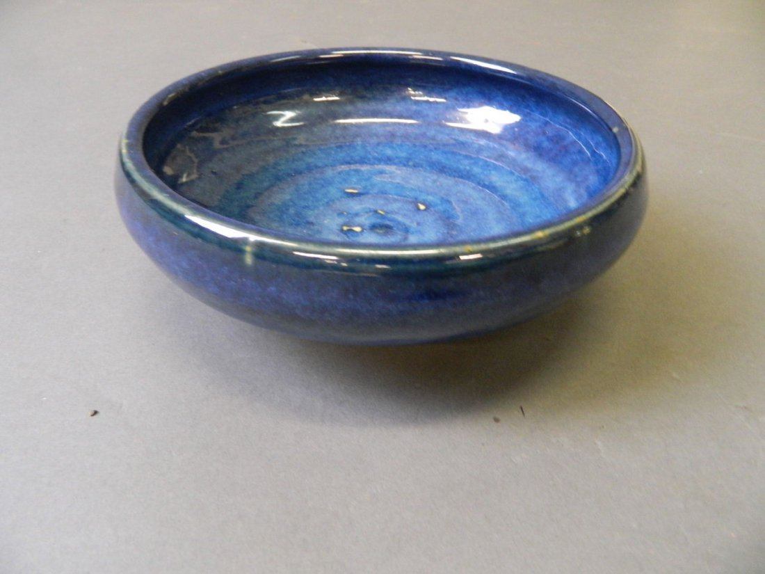 A Studio pottery bowl with blue glaze, impressed mark