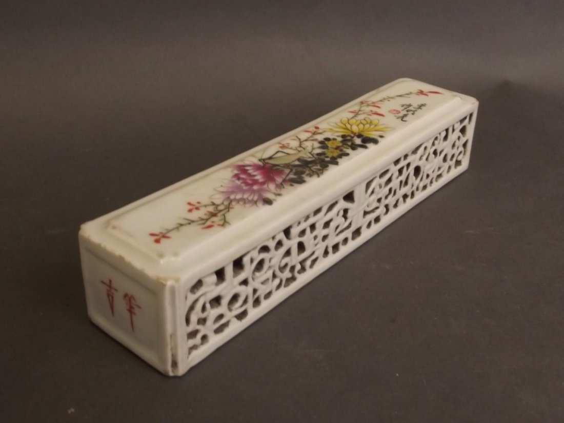 A Chinese porcelain wrist rest with pierced enamelled