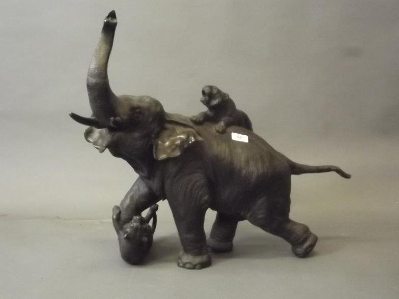 A large Japanese bronze figure of an elephant attacked
