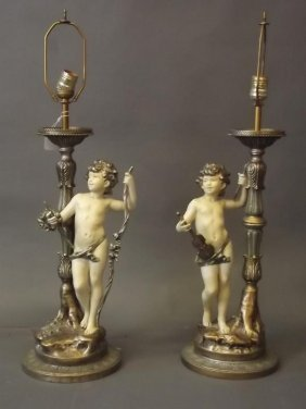 A Pair Of White Metal And Brass Table Lamps With Cold