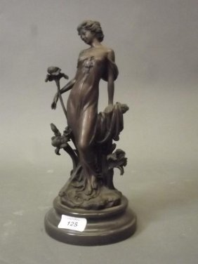 An Art Nouveau Style Bronze Figure Of A Young Woman