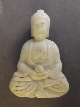 A Chinese Jade Pendant Carved In The Form Of Buddha