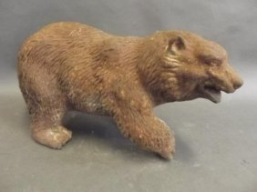 A Heavy Cast Iron Doorstop In The Form Of A Brown Bear,