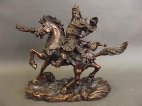 "A Chinese Bronze Figure Of A Warrior On Horseback, 9"" X"