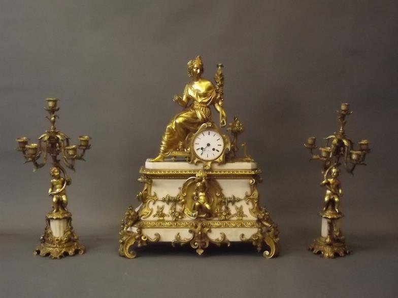 A C19th marble clock garniture with fine ormolu mounts,