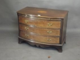 An Inlaid Mahogany Bow Fronted Chest Of Three Drawers