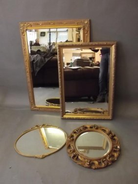 A Gilt Wall Mirror With Bevelled Glass, And Three