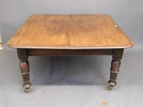 An Early Victorian Mahogany Draw Leaf Dining Table On
