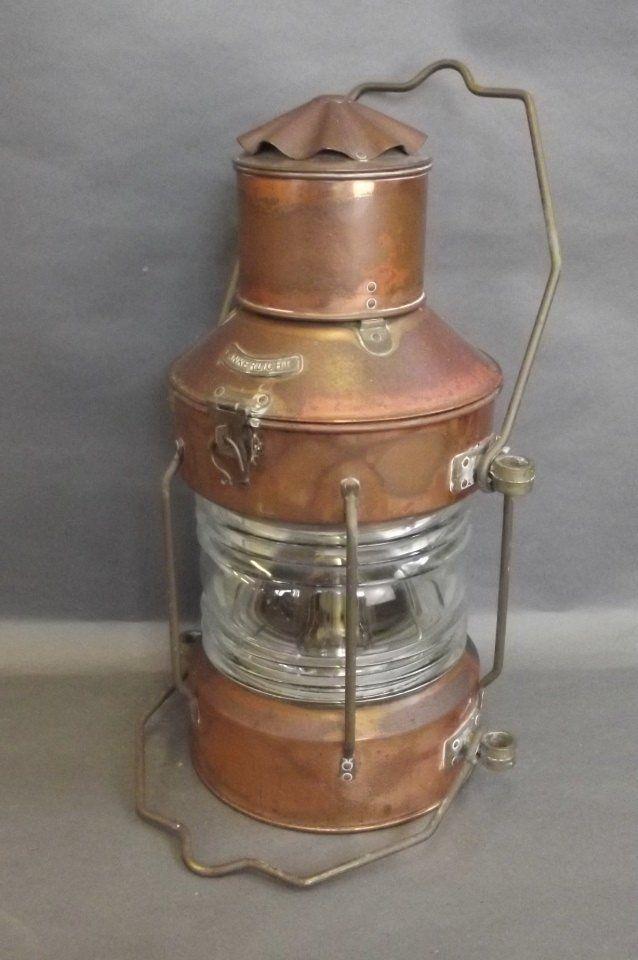 A Dutch copper and brass ship's anchor light, bears