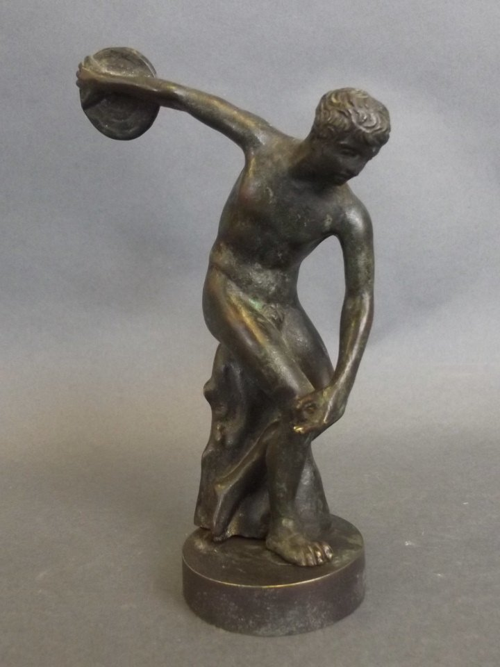 A small bronze figure of a discus thrower, on a