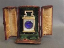 A miniature Mother of Pearl cased carriage clock with