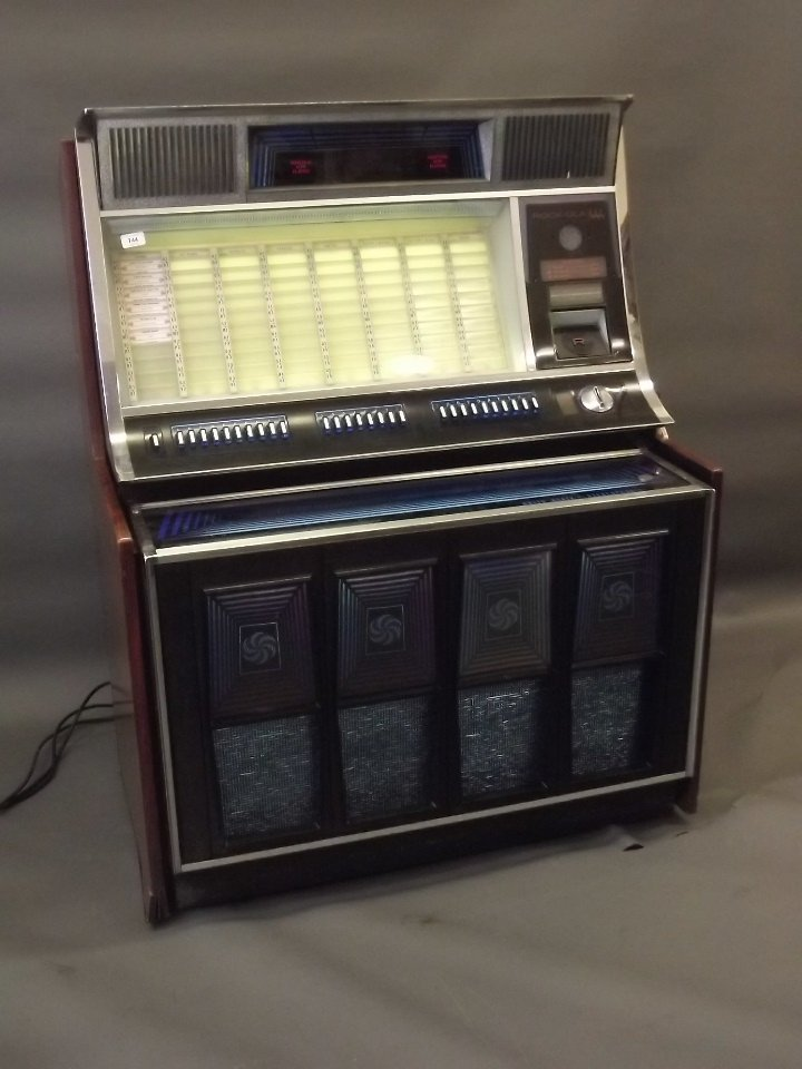 A 1970 Rock-Ola 444 stereophonic jukebox, appears in