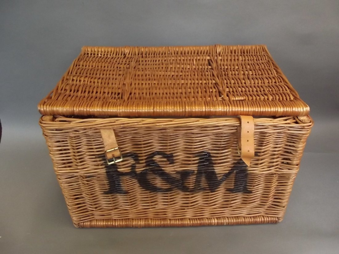 A Fortnum & Mason picnic basket with contents including