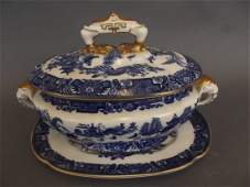 A Royal Worcester blue and white Willow pattern sauce