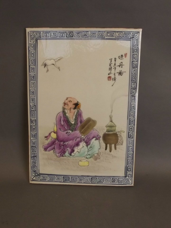 A Chinese polychrome enamel porcelain plaque decorated