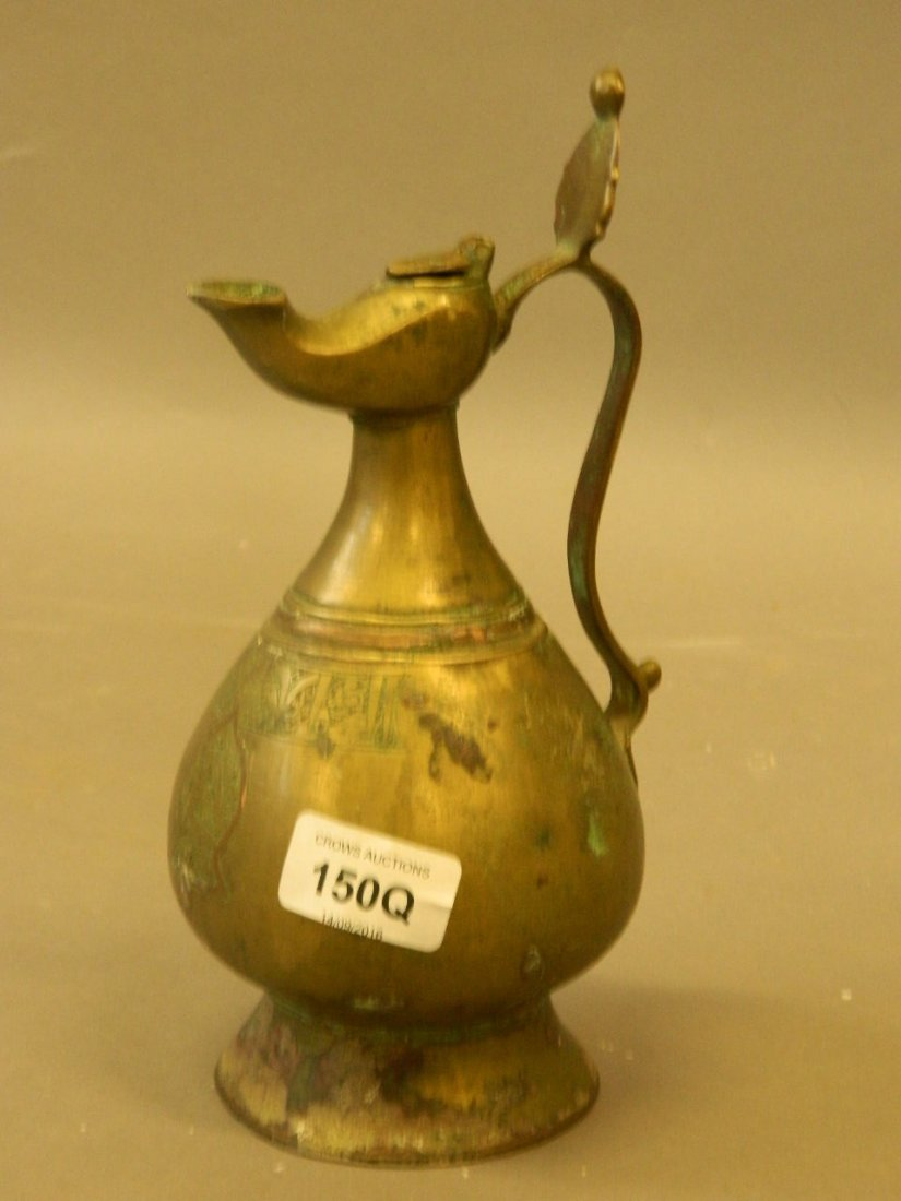 An antique Middle Eastern brass and copper inlaid wine