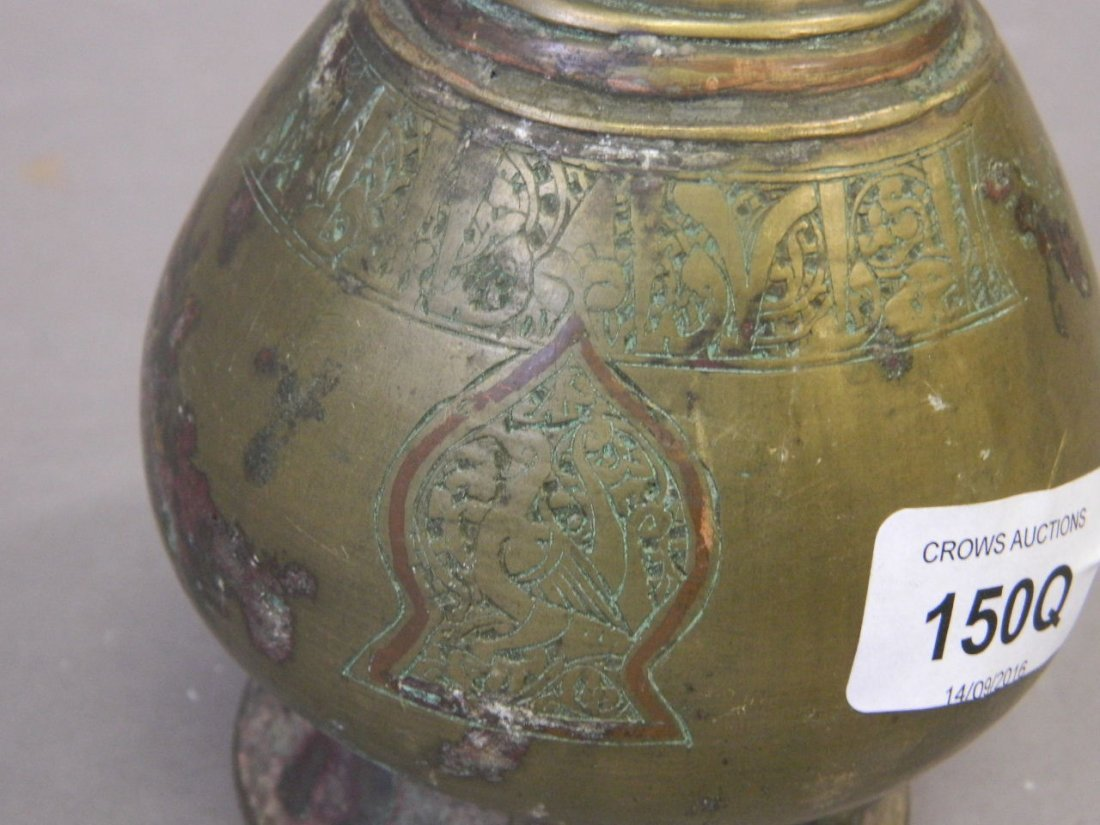 An antique Middle Eastern brass and copper inlaid wine - 2