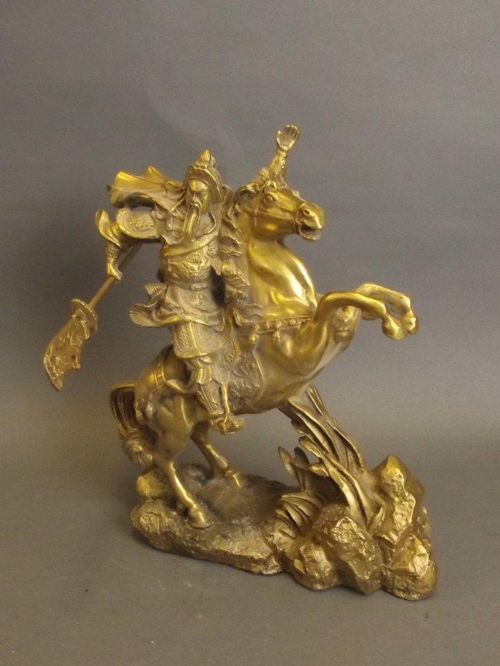 A Chinese gilt brass figure of a warrior on horseback,
