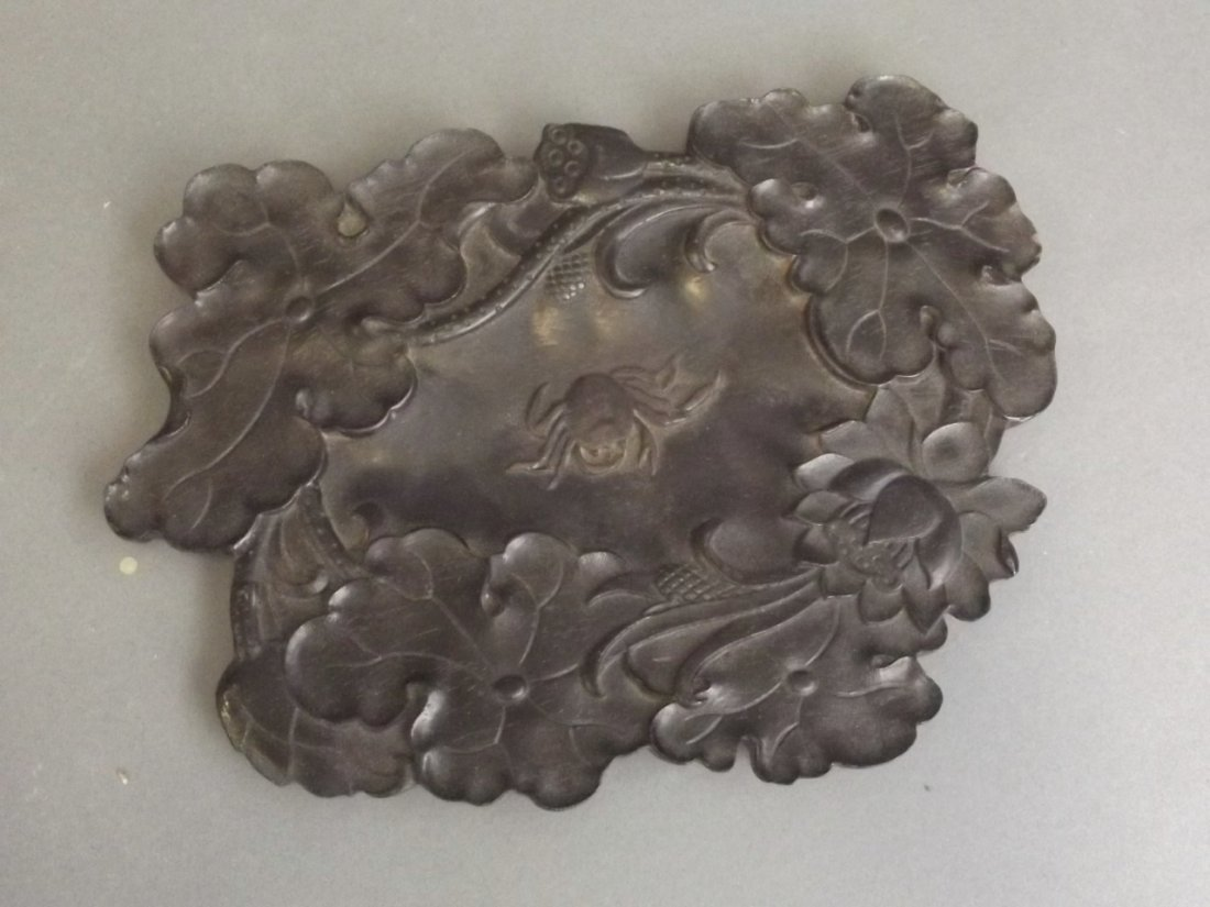 A Chinese carved and lacquered wood brush wash with