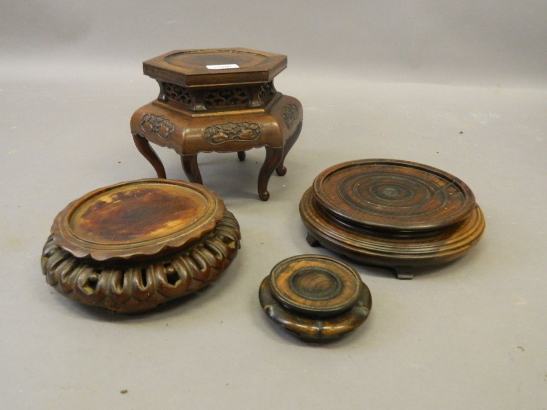 A Chinese hardwood vase stand with pierced frieze and