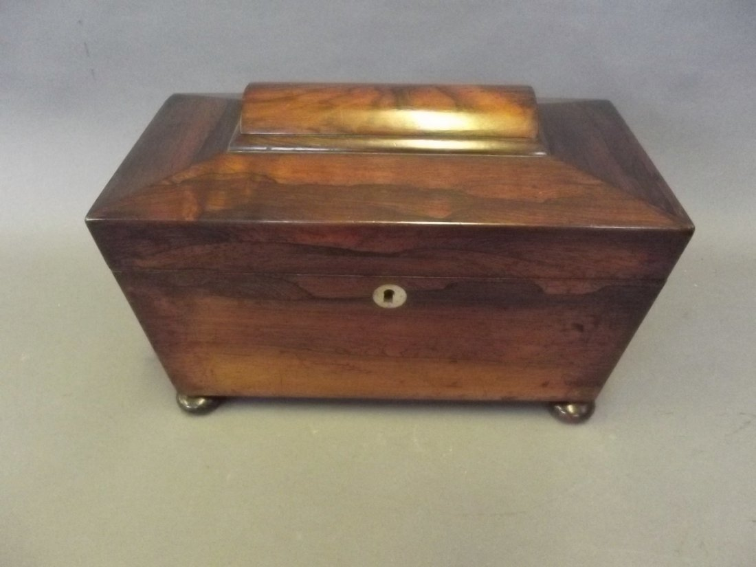 A Regency rosewood sarcophagus shaped tea caddy with