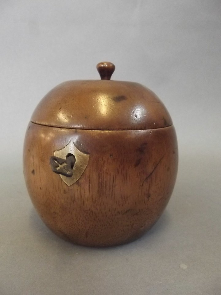 A fruitwood tea caddy in the form of an orange, 4½""