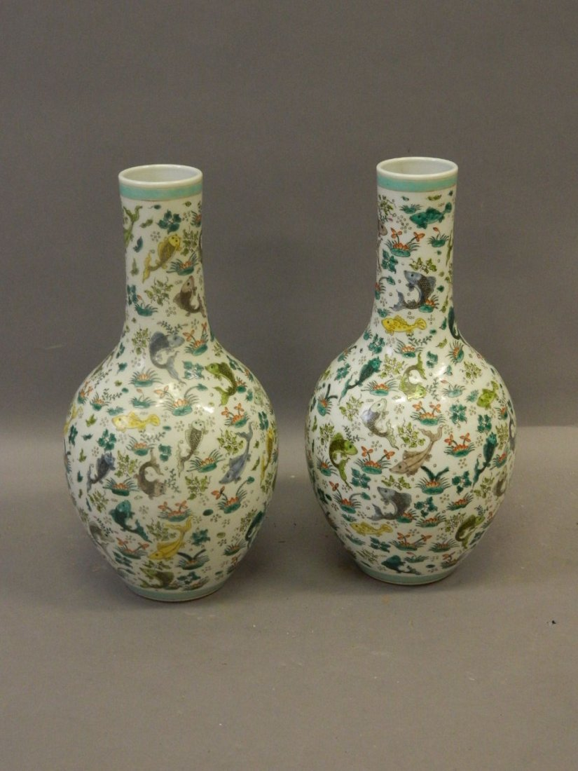 A pair of Chinese porcelain bottle vases with famille