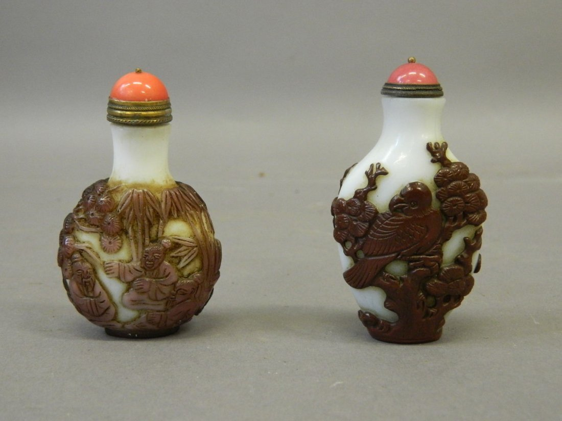 A Peking glass snuff bottle with overlaid carved