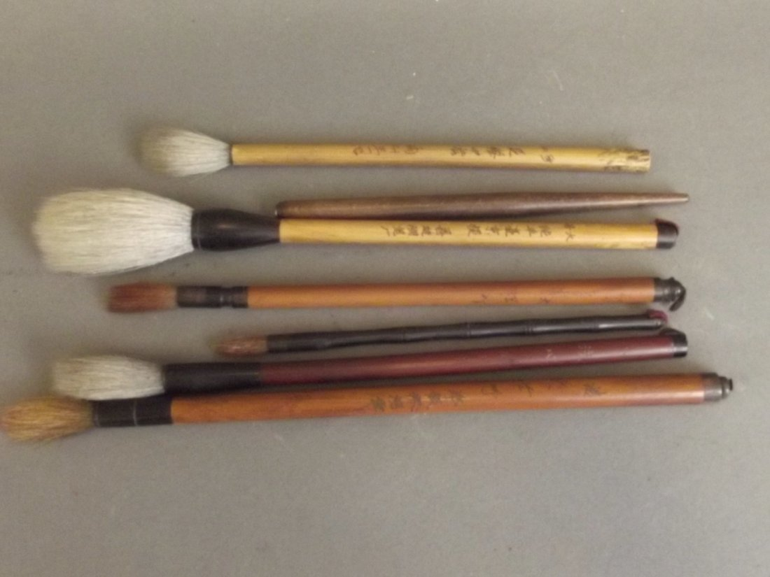 A collection of seven Chinese brushes, the handles