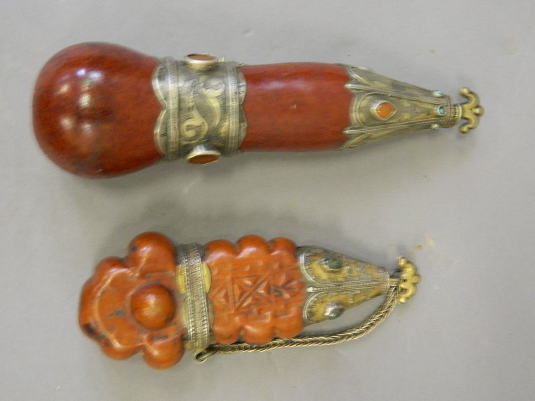 A Tibetan gourd flask with gilt washed white metal